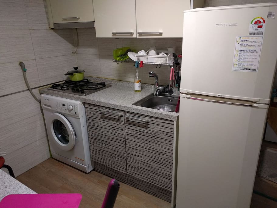 Shared kitchen, refrigerator and laundry machine