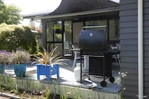 Brand new 4 burner gas BBQ on the deck for easy outdoor cooking. Utensils provided