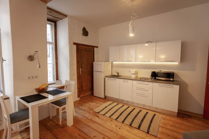 Ok, kitchen is quite modern. There are dishwasher, stove, microwave and coffeemaker.