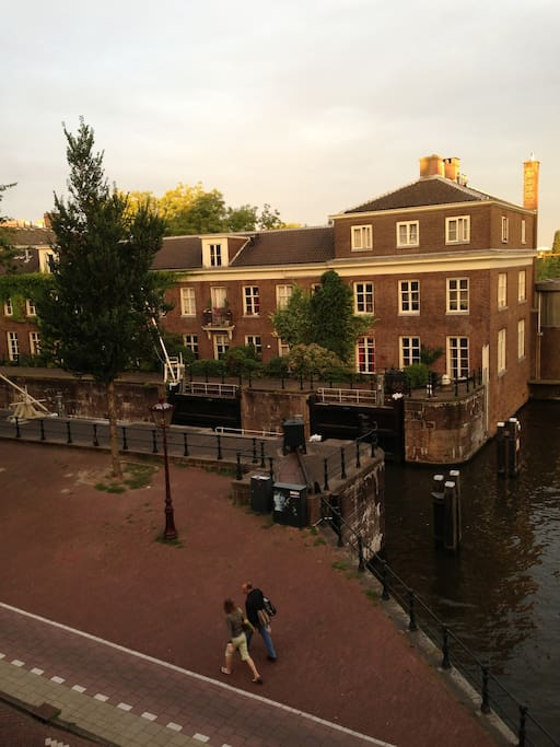view at the entrance of the monumental Scharrebiersluis that connects the Nieuwe Herengracht with Oosterdok