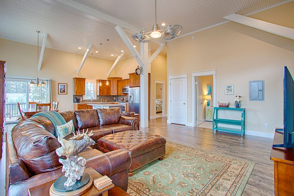 Open concept with 14' ceilings and original beams.