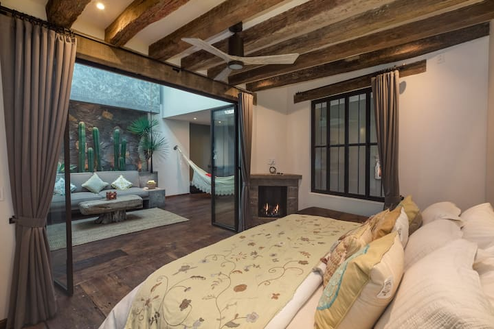 1st Floor Bedroom with reclaimed beams from the state of Michoacan