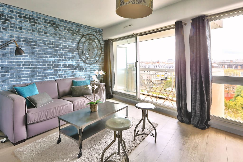 Sit on your comfortable sofa and enjoy the magnificent panoramic view of Paris