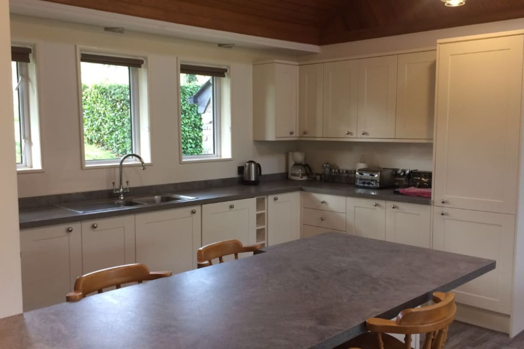 Kitchen with views to countryside. Fridge Freezer, Microwave, Oven, etc.