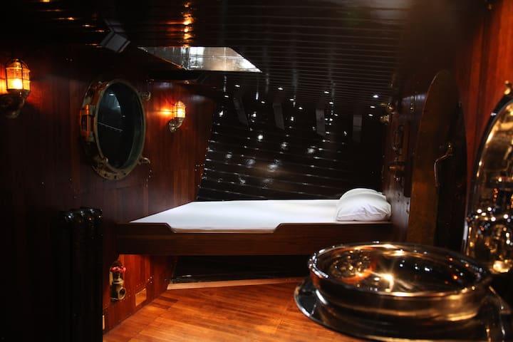 Historic ship captain's bow bedroom, Tower Bridge