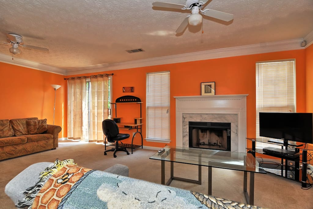 Living room with fireplace and access to the deck and back yard. Home is equipped with COMCAST TV and WIFI
