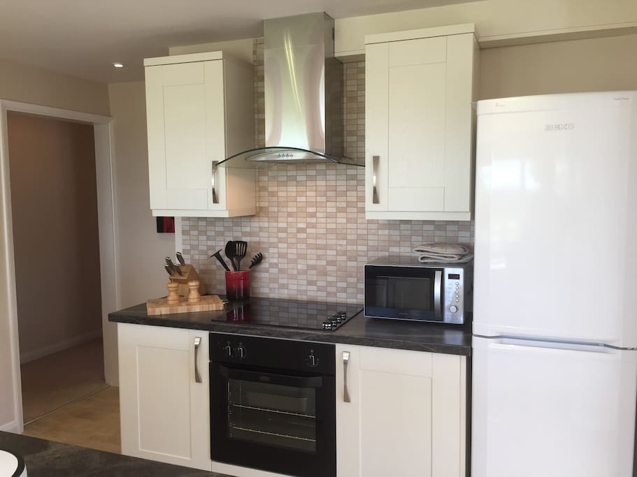 Fully equipped kitchen with fridge-freezer, dishwasher, full oven and microwave