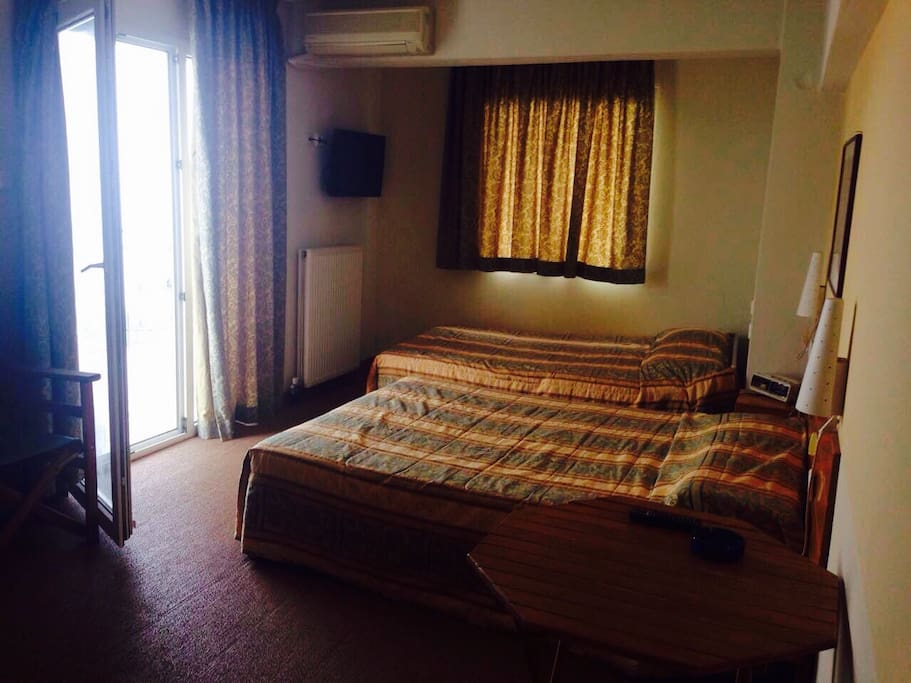 room with 2 double beds, balcony with sea view