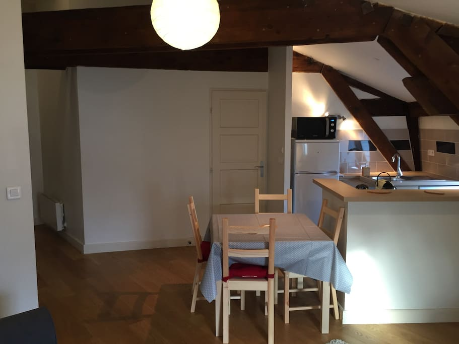 Dining table and open kitchen