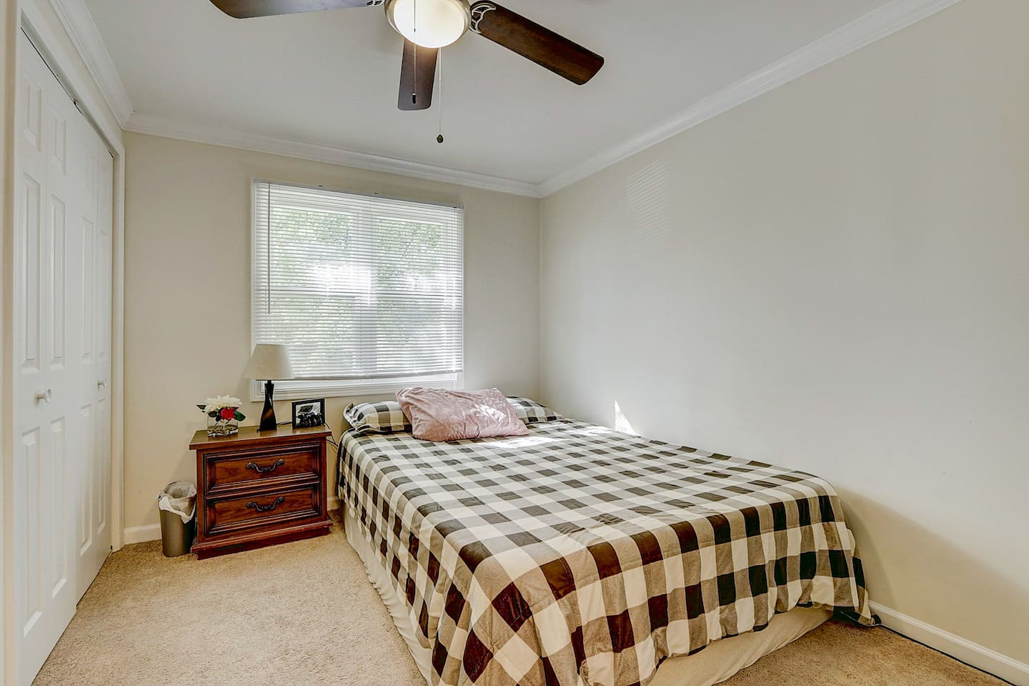 Large Queen Bed in spacious private room with dual closets.