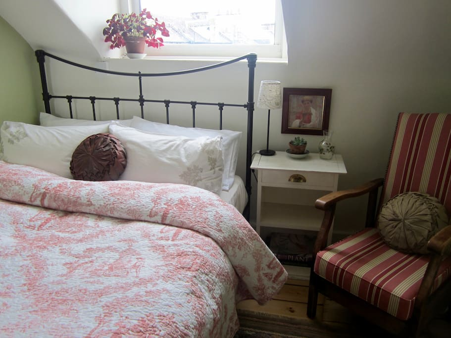 Bed made with high quality cotton sheets & feather duvet & pillows