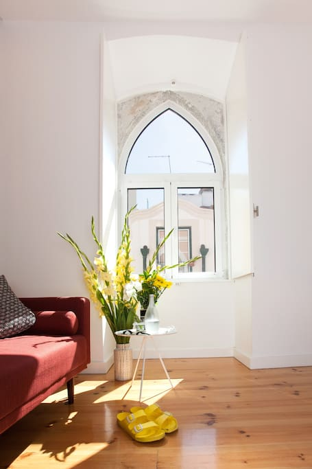 The sunny living room is the place to relax, after exploring the city's vibrant life