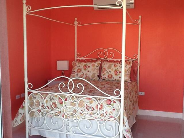 At the top of the stairs you will find the first bedroom we refer to as the Coral room! It's furnished with a full sized bed, a large closet, its own A/C, an ultra quiet ceiling fan, black out curtains & a MASSIVE walk out deck!