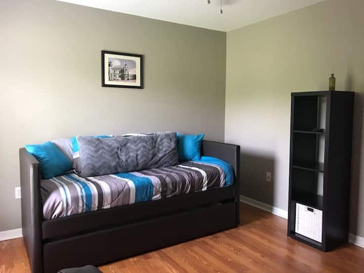 Convenient attached apartment behind family home.