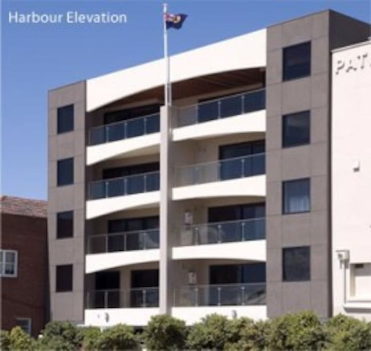 Harbourside apartments when viewed from the Harbour. The first white balcony on the right is that off #2.