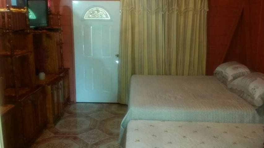Stay with my Local Family (Private Room) - Negril - House