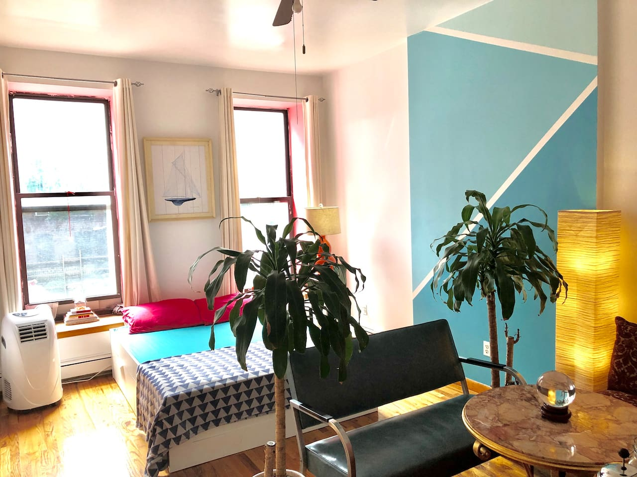 This is as much of the room as we could capture in a single shot. We've made the most of the generously sized space with our new arrangement - enjoy a good night's sleep and wake up to the french press in your cozy living area!