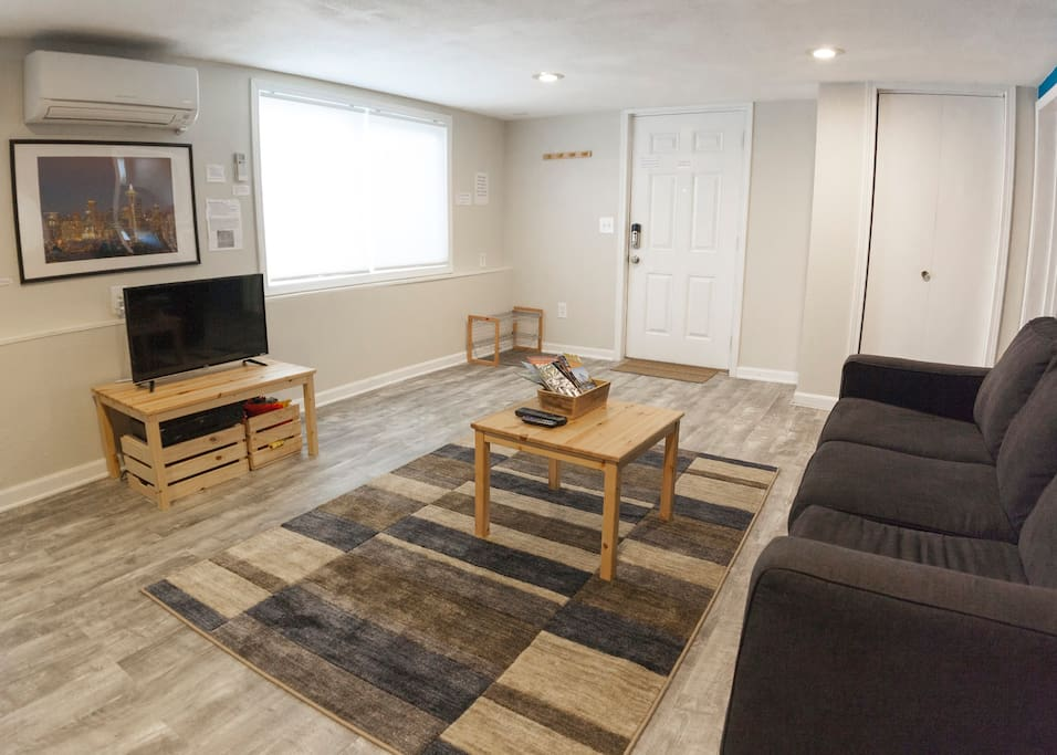 A comfortable and open living room!  Features a queen-sized pull-out sofa bed with a memory foam mattress.  Relax after a long day of exploring to a Roku-enabled TV and a wide-selection of books.  The spacious dining table doubles as a working desk for business travelers.