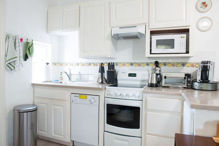 Fully stocked kitchen with the conveniences that you need, including a stove/oven, dishwasher and all utensils