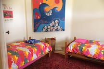 Two single beds and some fun artwork for the kids or young at heart!