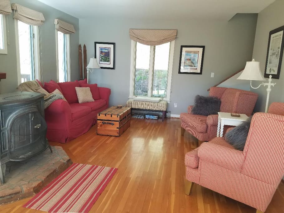 Relax on the comfortable chairs or pottery barn couch in this freshly-painted living room.