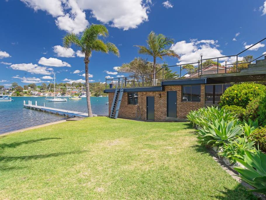 Level lawn area to water and jetty. Boat shed with unique 20m deck above to enjoy the view.