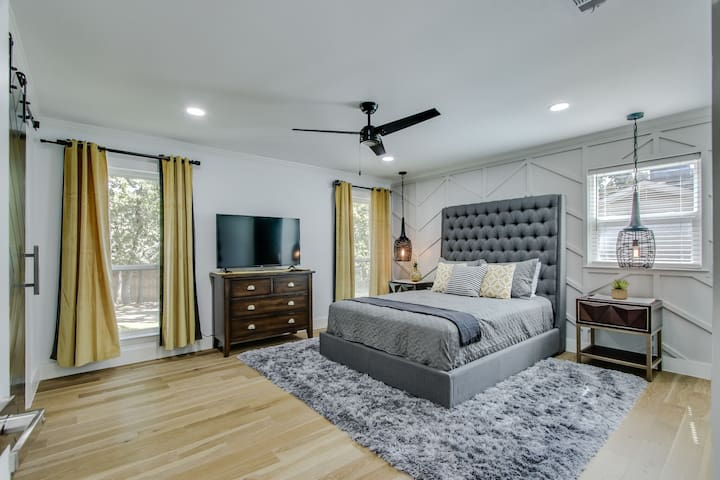 Spacious master bedroom with a Queen size bed comfortable bedding .