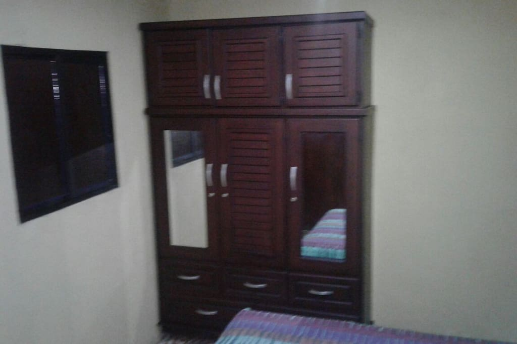 picture of one of our double rooms with a maletero and closet