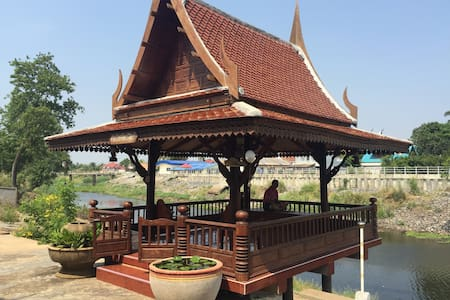 Traditional Thai house near river