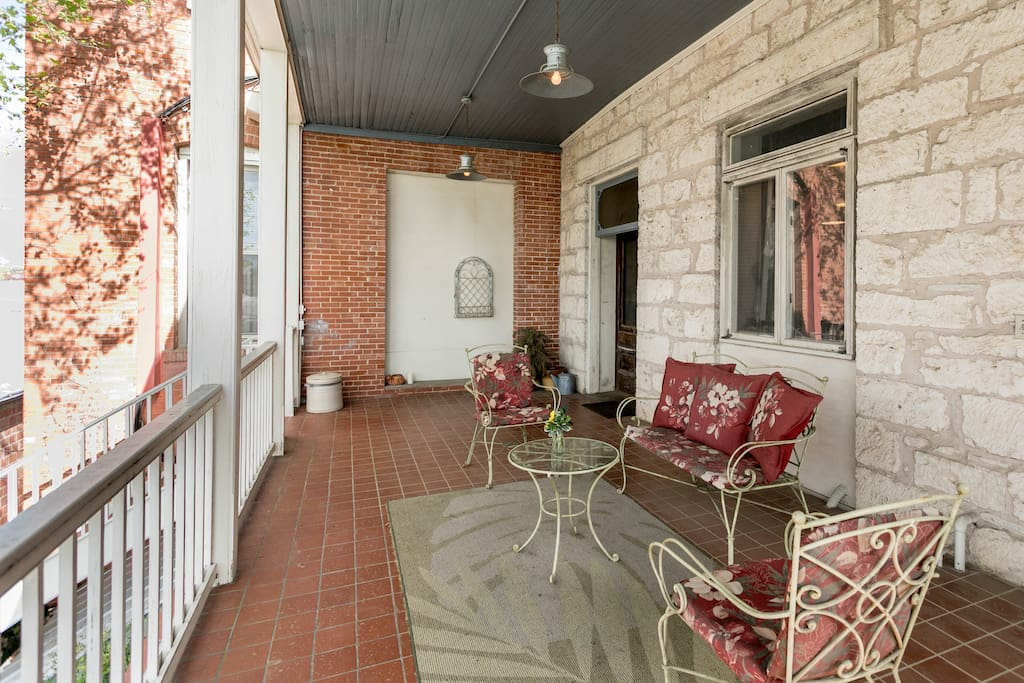 Common back porch overlooking a walled courtyard