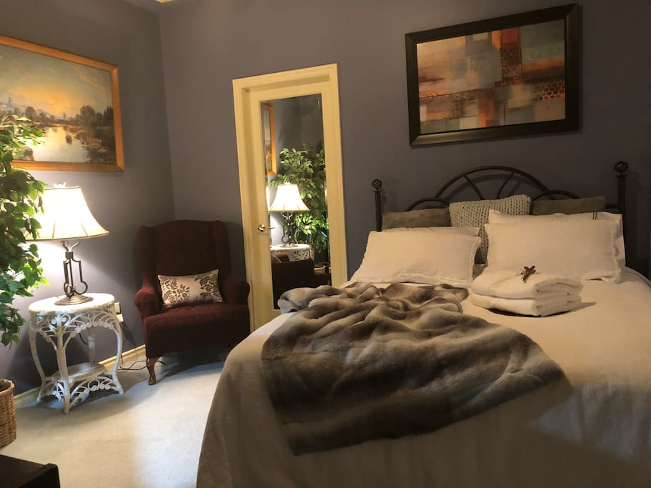 Nicely decorated master bedroom with  top of the line linen bedding
