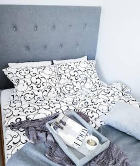 """queen bed in the """"grey room""""."""