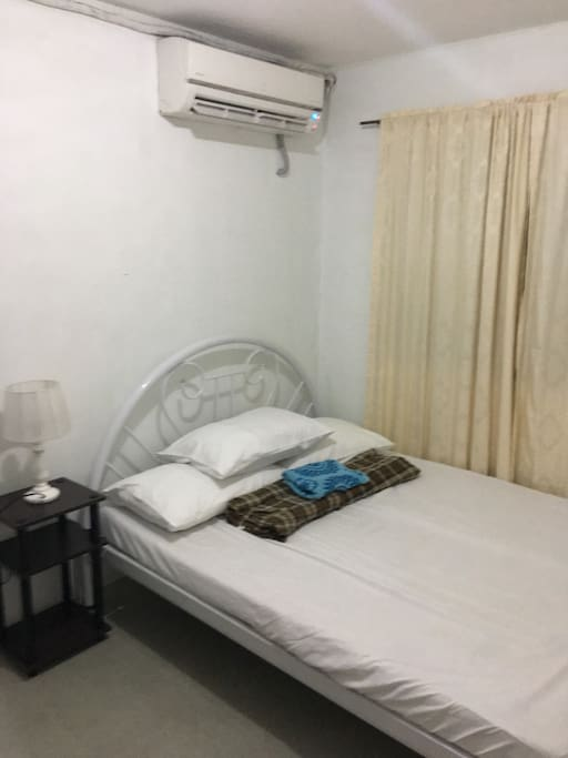 Bedroom 2 with king size bed and split typed aircon