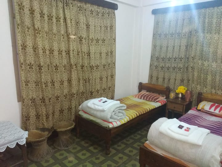 Double bed room with common bathroom.