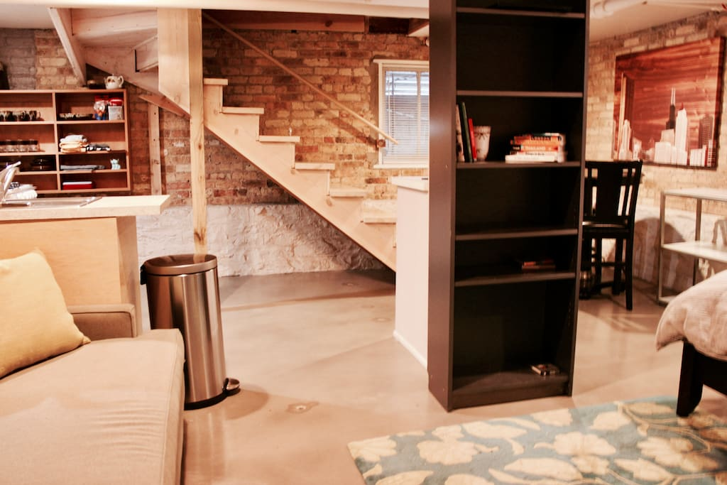 Open floor plan with plenty of storage space under stairs