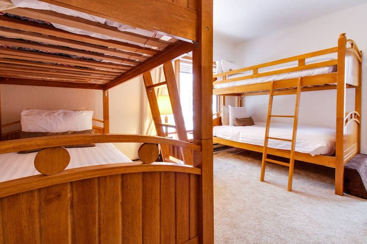Bunk beds in kids bunk room on 2nd floor with deck with mountain views, full bath, TV, Apple TV and DVD player