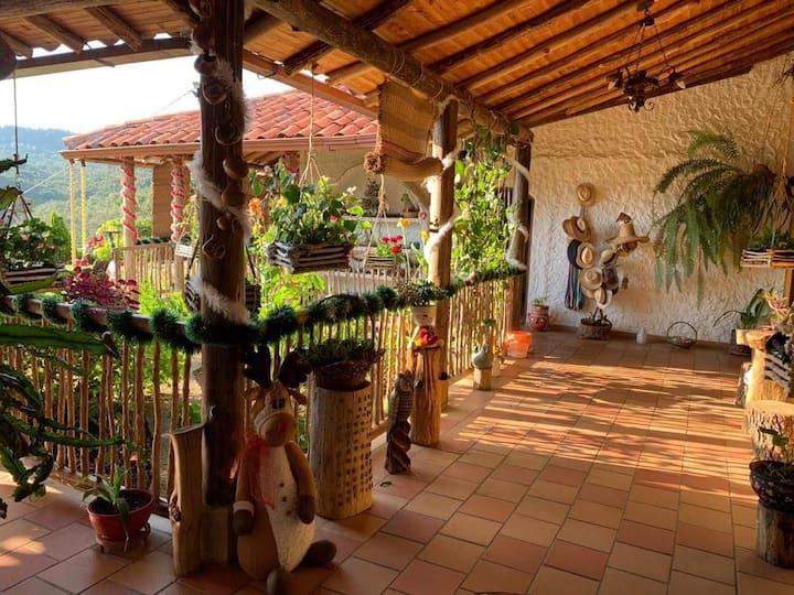 Habitación casa de campo clima suave y naturaleza.