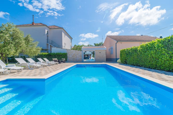 Apartment with  an open swimming pool view