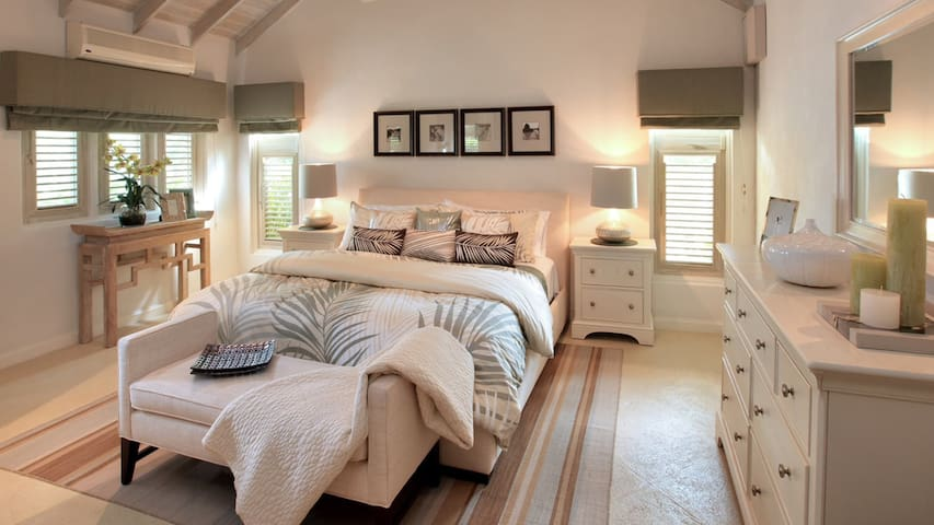 Air conditioned master with king bed and ensuite bathroom.