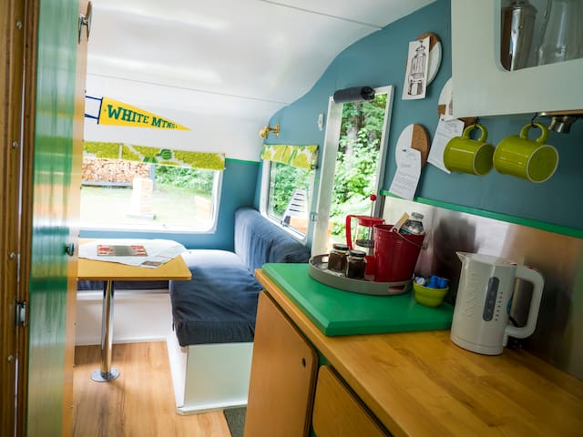 A vintage 1970's British-style caravan re-imagined into a luxury glamping getaway
