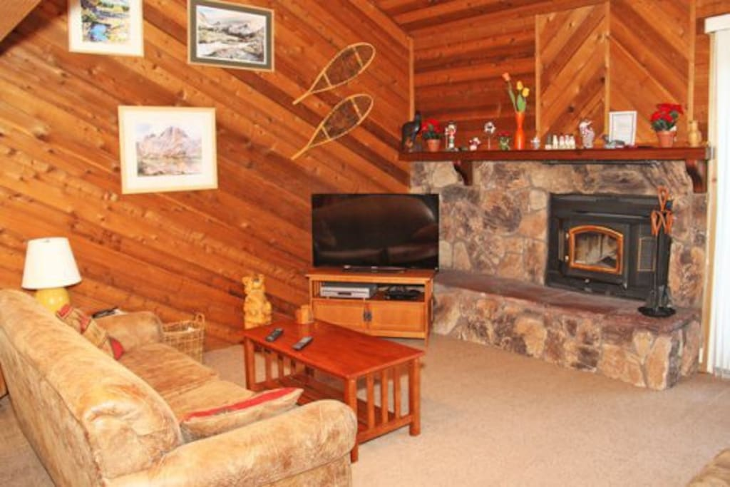 Mammoth Condo Rental Snowflower 11 - LR has a Fireplace, Large Flat Screen TV and Outside Deck Access. Firewood is not provided. Guest will need to purchase their own firewood.