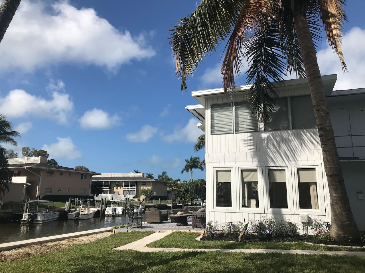 Beautiful Renovated Waterfront Old Florida Style apartment on canal, less than 2 miles from the beach. Dock your boat right next to your spacious open air patio and relax while enjoying the sunset and  fishing from your vacation home!