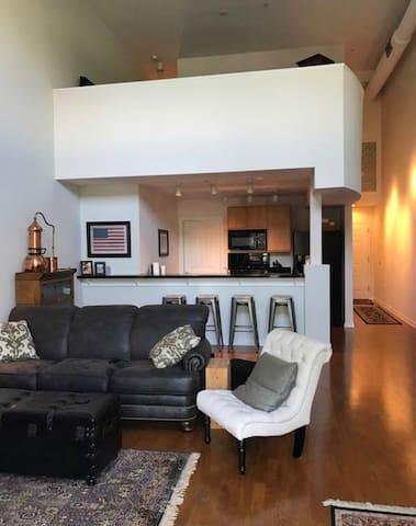 Living room with loft bedroom