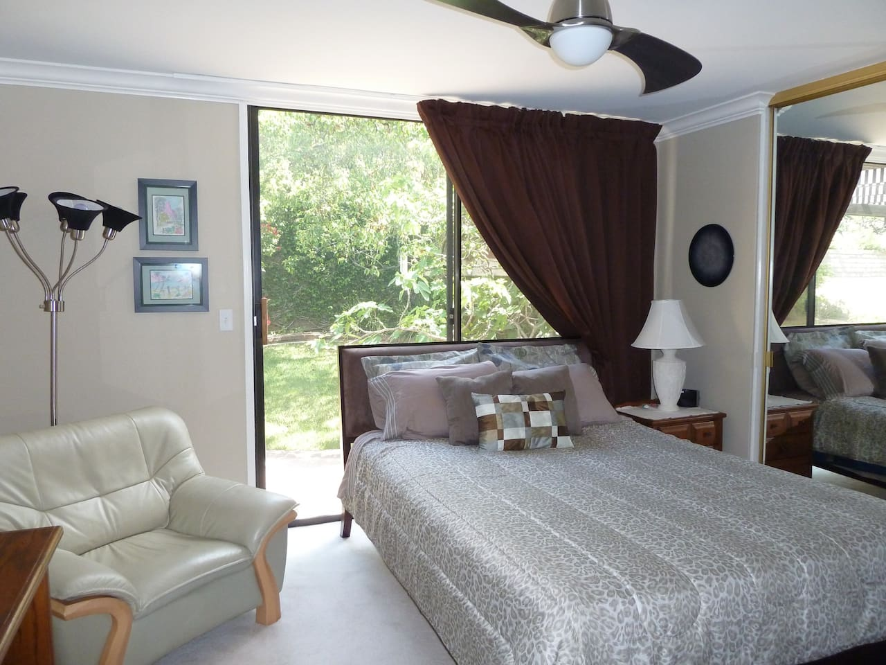 New Queen size  bed and blackout curtains for a good nights sleep!  Ceiling fan for summer comfort with dimmable light.