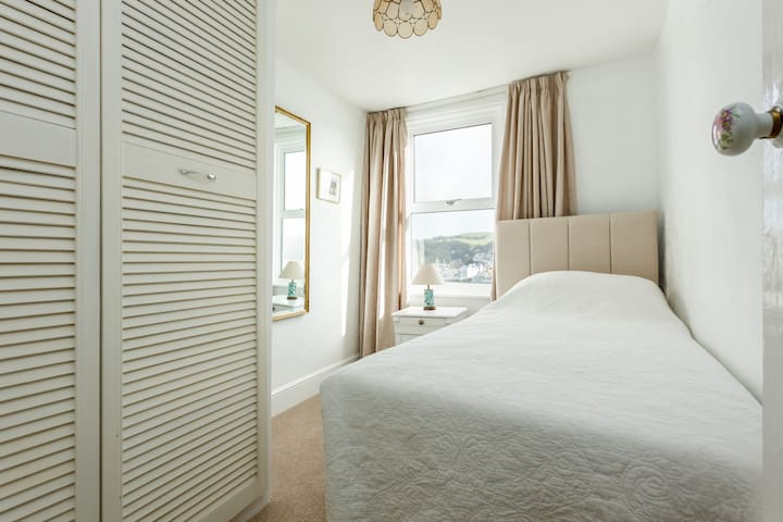 4th bedroom, single bed, view over the river