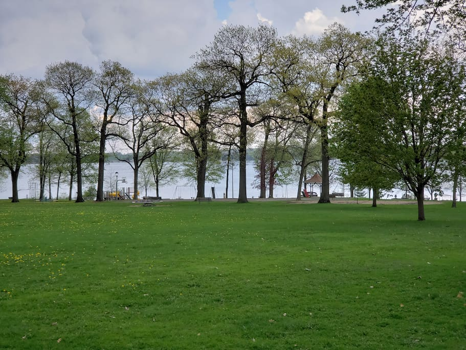 Large Park with baseball diamond, playground, volleyball, and beach on Delavan Lake.