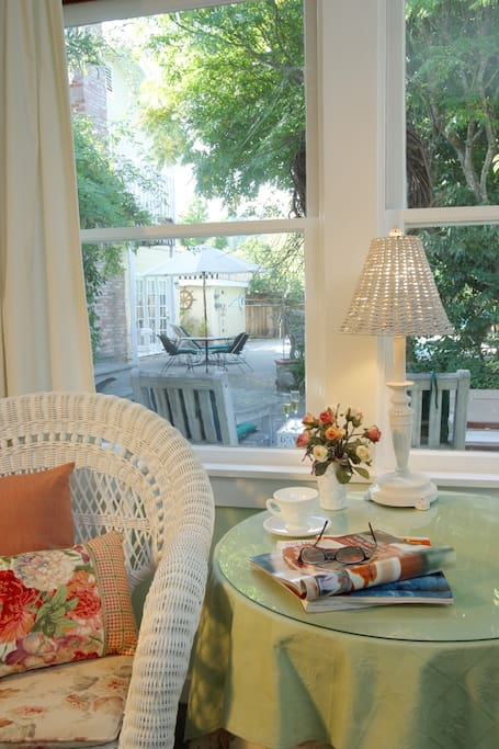 Enjoy plenty of natural light and views of the lush gardens from the Garden Room.