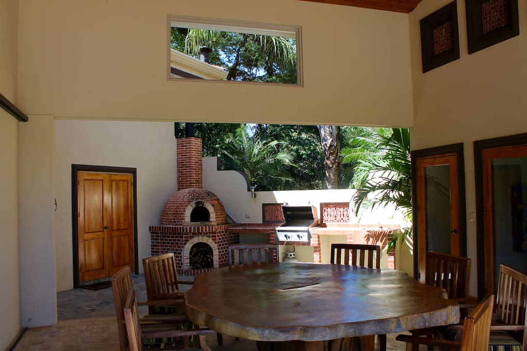 Enjoy the brick Pizza Oven, propane grill, and out door seating area.