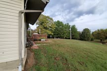 Side yard off deck. Large yard, but hilly.
