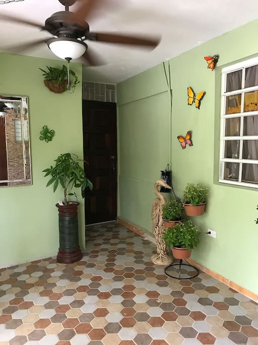 Hallway that leads to your private oasis.  Has ceiling fans to feel the breeze from the mango trees.  Caribbean decor and vibe.  Very private and safe